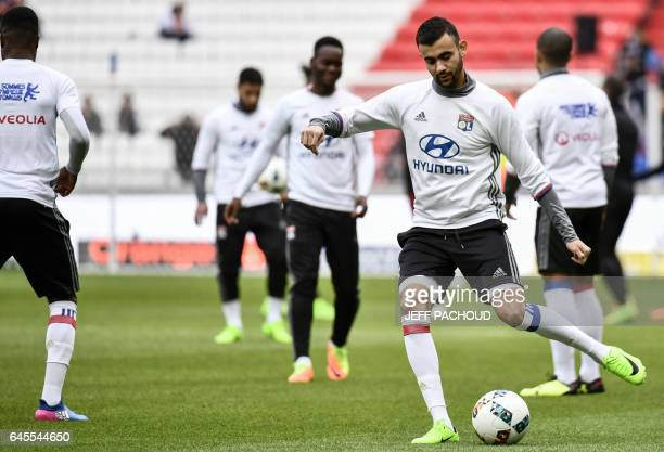 Lyon's French Algerian midfielder Rachid Ghezzal warms up prior to the French L1 football match FC Metz against Olympique Lyonnais at Parc Olympique...