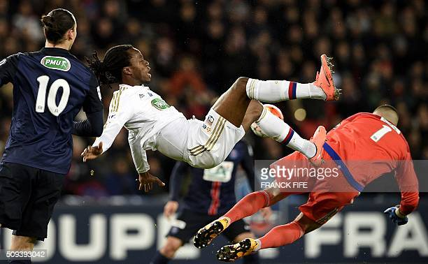 TOPSHOT Lyon's French Burkinabe defender Bakary Kone and Lyon's FrenchPortuguese defender Anthony Lopes jump for the ball during the French Cup round...