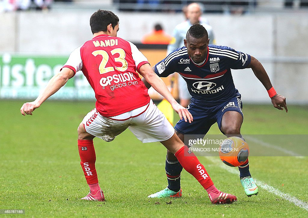 Lyon's French Cameroonian defender Henri Bedimo N'Same (R) vies with Reims' defender Aissa Mandi during a French L1 Football match between Reims and Lyon on January 19, 2014 at the Auguste Delaune Stadium in Reims.