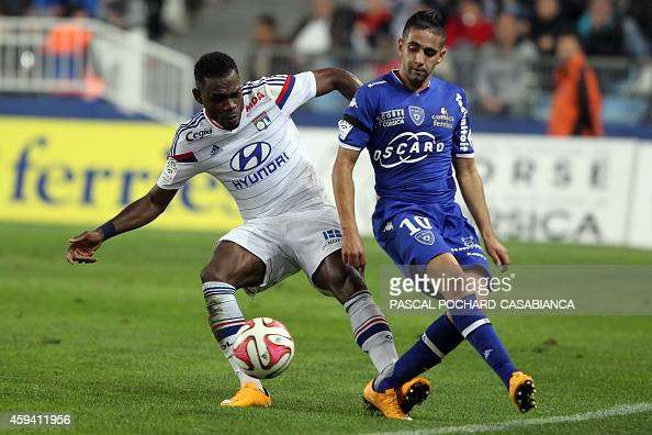 Lyon's French Cameroonian defender Henri Bedimo vies with Bastia's Franco Algerian midfielder Ryad Boudebouz during the French L1 football match...