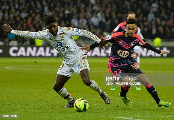 Lyon's French Cameroonian defender Samuel Umtiti vies with Bordeaux's French midfielder Adam Ounas during the French L1 football match Lyon vs...