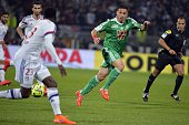 Lyon's French Cameroonian defender Samuel Umtiti vies with St Etienne's Turkish forward Mevlut Erding during the French L1 football match between...