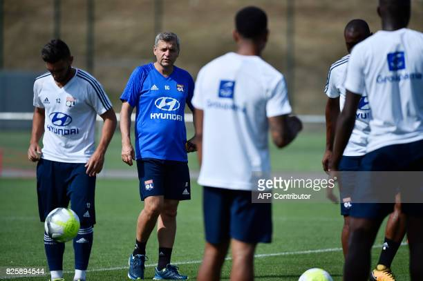 Lyon's French coach Bruno Genesio takes part in a training session on August 3 2017 at the Parc Olympique Lyonnais in Lyon eastern France ahead of...
