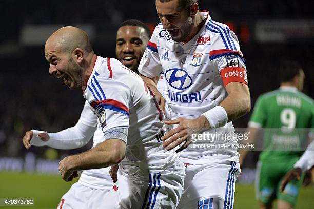 Lyon's French defender Christophe Jallet celebrates with teammates after scoring a goal during the French L1 football match between Lyon and...