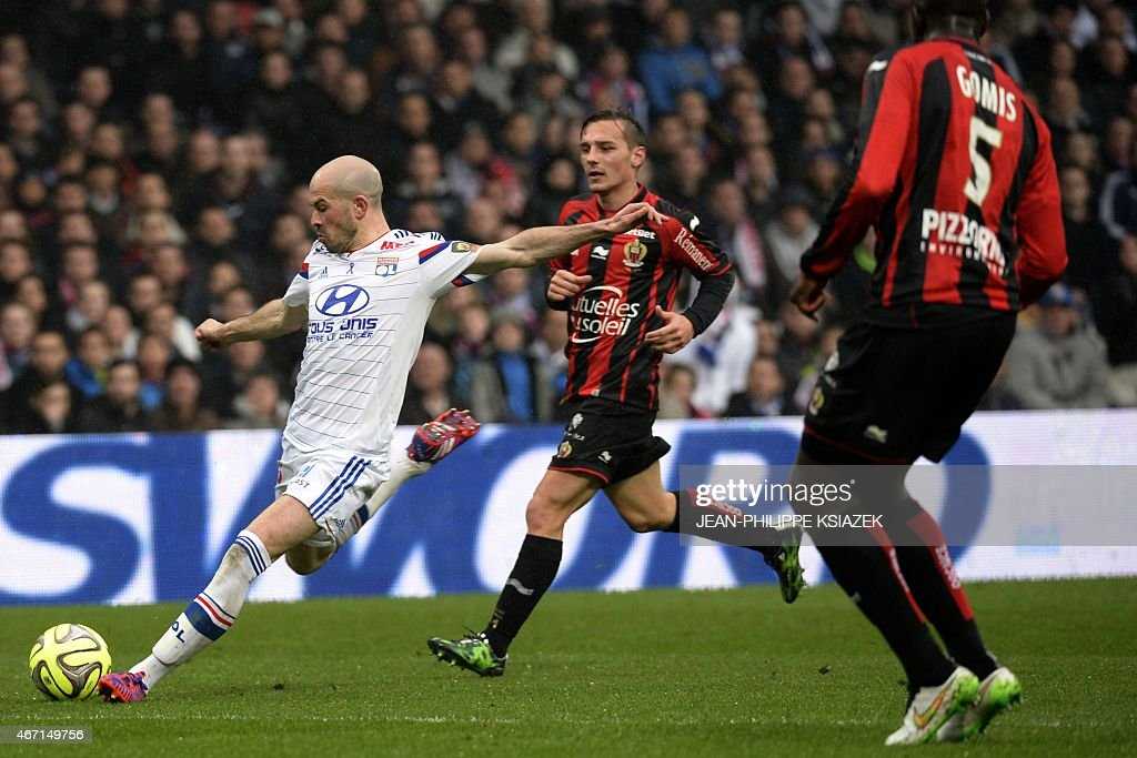 Lyon's French defender <a gi-track='captionPersonalityLinkClicked' href=/galleries/search?phrase=Christophe+Jallet&family=editorial&specificpeople=2264495 ng-click='$event.stopPropagation()'>Christophe Jallet</a> (L) kicks the ball next to Nice's French midfielder Eric Bautheac (C) during the French L1 football match between Lyon and Nice on March 21, 2015, at the Gerland stadium in Lyon, central eastern France.