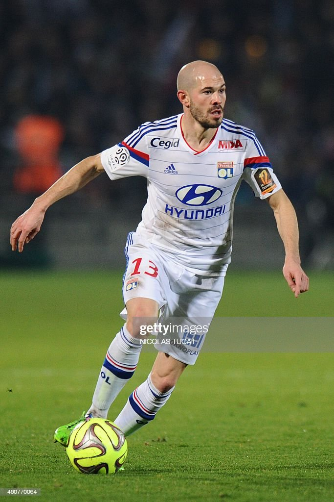 Lyon's French defender <a gi-track='captionPersonalityLinkClicked' href=/galleries/search?phrase=Christophe+Jallet&family=editorial&specificpeople=2264495 ng-click='$event.stopPropagation()'>Christophe Jallet</a> runs with the ball during the French L1 football match between Girondins de Bordeaux (FCGB) and Lyon (OL) on December 21, 2014 at the Chaban-Delmas stadium in Bordeaux, southwestern France.