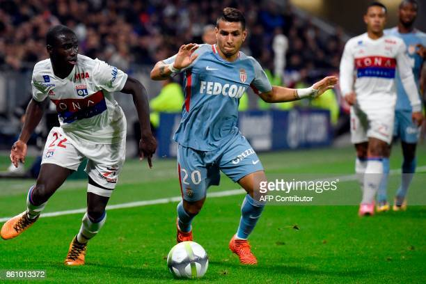 Lyon's French defender Ferland Mendy vies with Monaco's Portuguese midfielder Marcos Lopes Mesquita during the French L1 football match between Lyon...