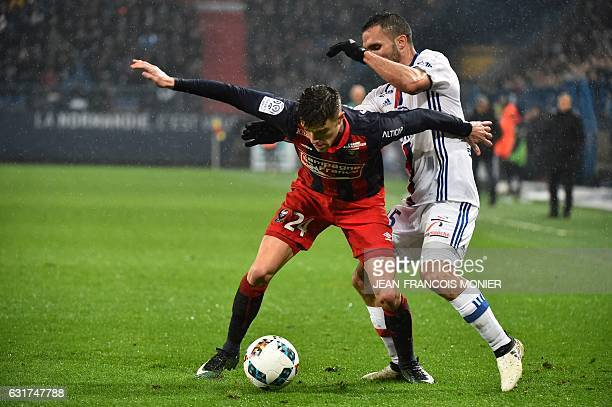 Lyon's French defender Frederic Guilbert fights for the ball with Caen's French defender Jeremy Morel during the French L1 football match between...