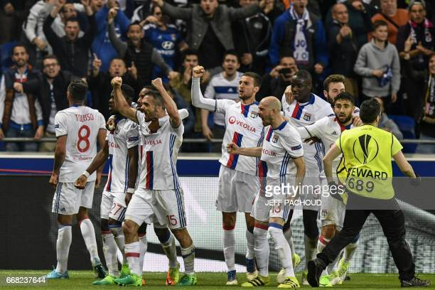 Lyon's French defender Jeremy Morel celebrates with teammates after scoring a goal during the UEFA Europa League first leg quarter final football...