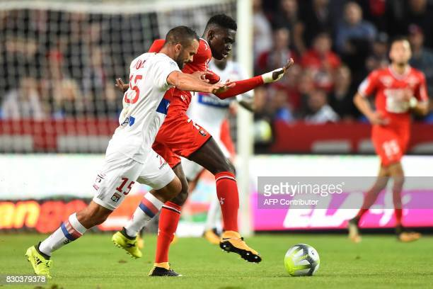 Lyon's French defender Jeremy Morel vies for the ball with Rennes' Senegalese forward Ismaila Sarr during the French L1 football match between Rennes...