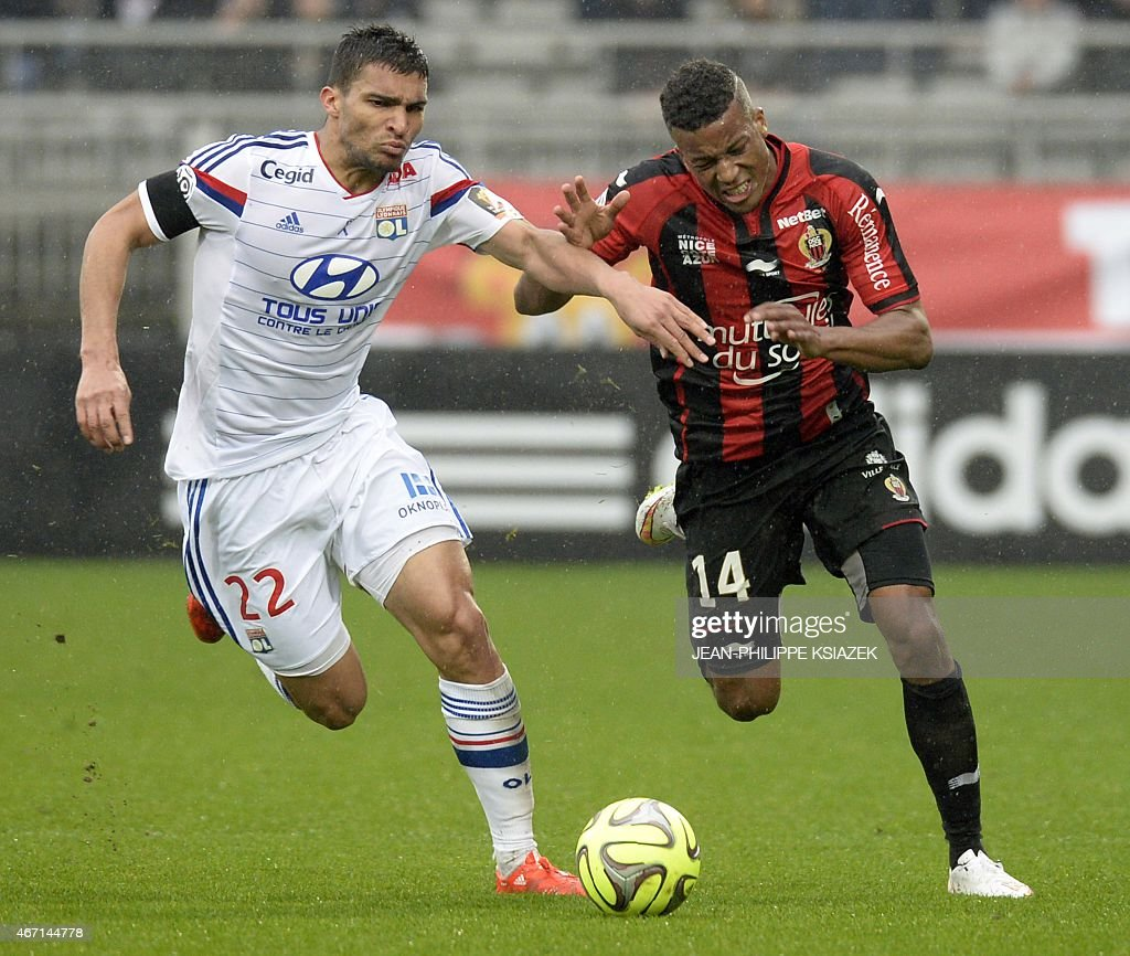 Lyon's French defender Lindsay Rose (L) vies with Nice's French forward Alassa Plea (R) during the French L1 football match between Lyon and Nice on March 21, 2015, at the Gerland stadium in Lyon, central eastern France.
