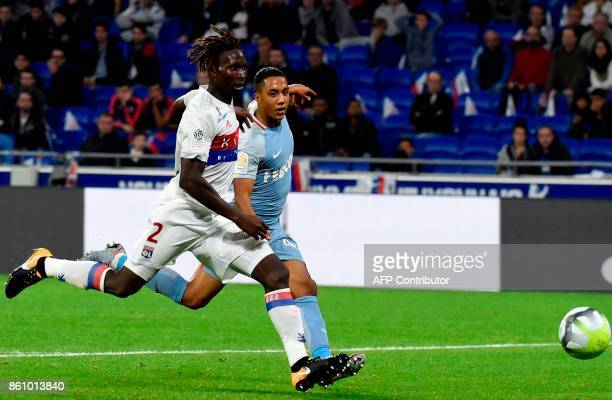 Lyon's French defender Mapou YangaMbiwa fights for the ball against Monaco's Belgian midfielder Youri Tielemans during the French L1 football match...
