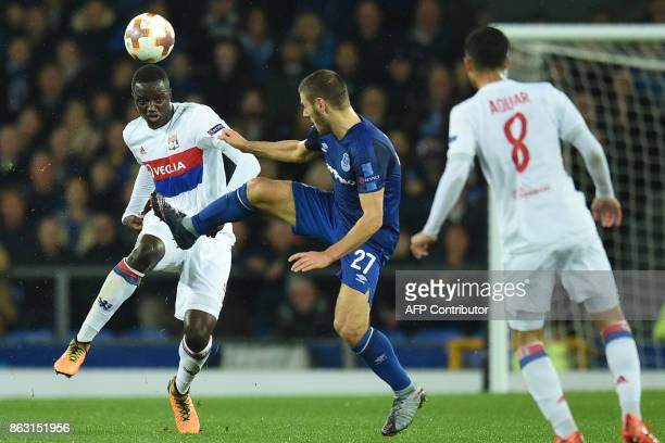 Lyon's French defender Mouctar Diakhaby vies with Everton's Croatian striker Nikola Vlasic during the UEFA Europa League Group E match between...