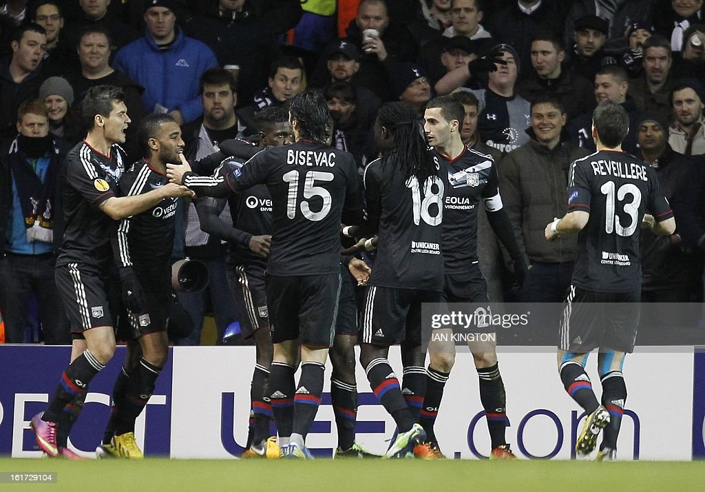 Lyon's French defender Samuel Umtiti (3rd L) celebrates scoring a goal during the Europa League Round of 32 football match between Tottenham Hotspur and Lyon at White Hart Lane in London, England, on February 14, 2013. Tottenham Hotspur won 2-1.