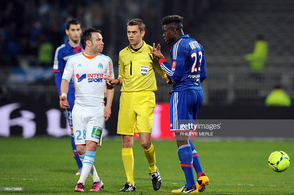Lyon's French defender Samuel Umtiti (R) talks with Marseille's French midfielder Mathieu Valbuena during the French L1 football match Lyon vs Marseille on March 10, 2013 at the Gerland stadium in Lyon.