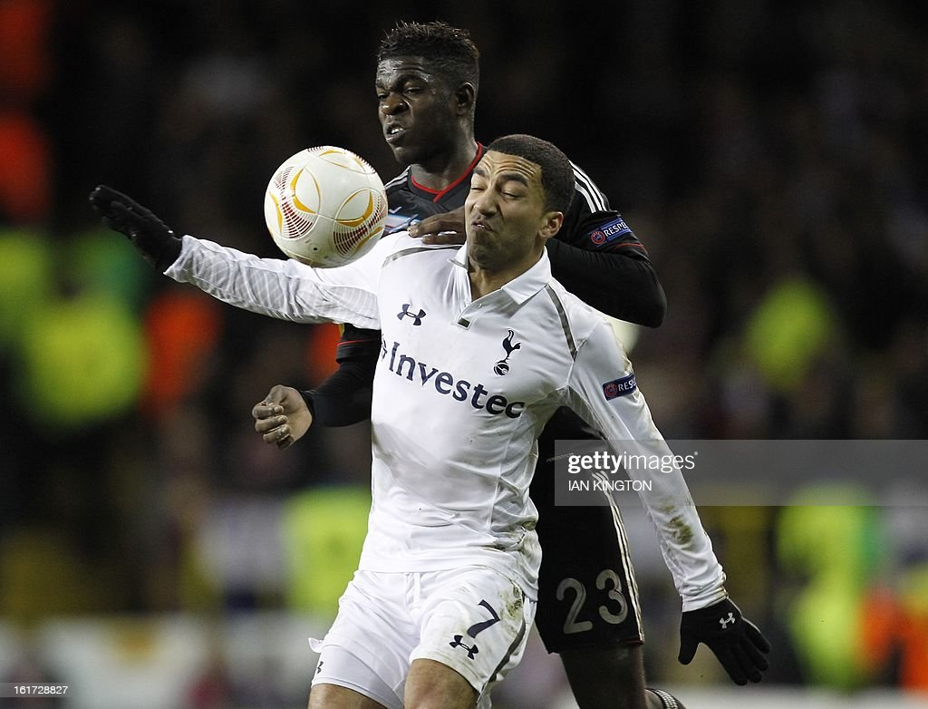 Lyon's French defender Samuel Umtiti (L) vies with Tottenham Hotspur's English midfielder Aaron Lennon during the Europa League Round of 32 football match between Tottenham Hotspur and Lyon at White Hart Lane in London, England, on February 14, 2013.