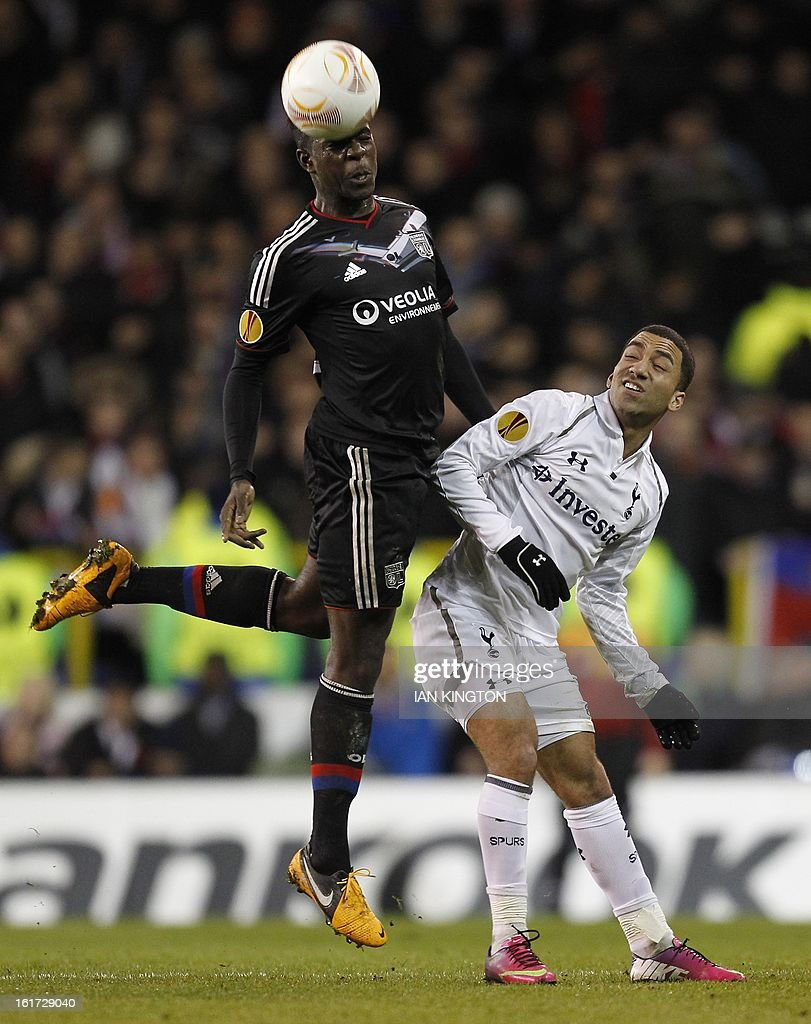 Lyon's French defender Samuel Umtiti (L) vies with Tottenham Hotspur's midfielder Aaron Lennon during a Europa League Round of 32 football match between Tottenham Hotspur and Lyon at White Hart Lane in London, England, on February 14, 2013. Tottenham Hotspur won 2-1.