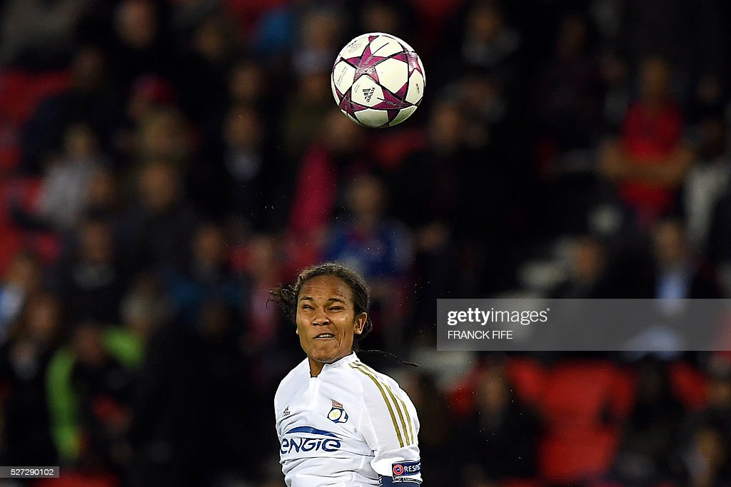 Lyon's French defender Wendie Renard heads the ball during the UEFA Women's Champions League semi-final second leg football match between Paris Saint-Germain (PSG) and Lyon at the Parc des Princes stadium in Paris on May 2, 2016. / AFP / FRANCK