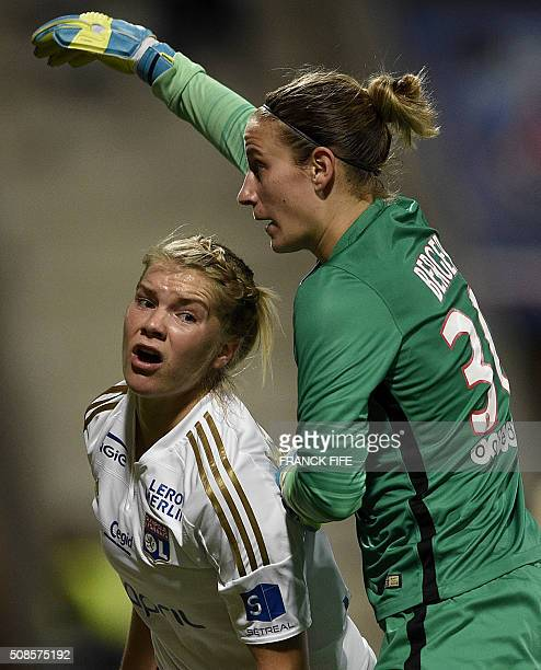 Lyon's French forward Ada Hegerberg reacts next to Paris SaintGermain's German goalkeeper AnnKatrin Berger during the French Women's D1 football...