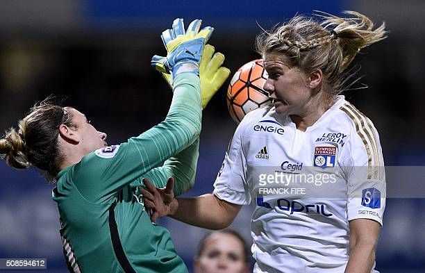 Lyon's French forward Ada Hegerberg vies with Paris SaintGermain's German goalkeeper AnnKatrin Berger during the French Women's D1 football match...