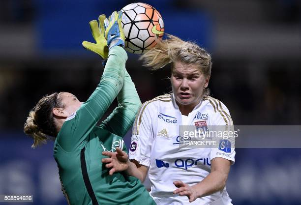 TOPSHOT Lyon's French forward Ada Hegerberg vies with Paris SaintGermain's German goalkeeper AnnKatrin Berger during the French Women's D1 football...