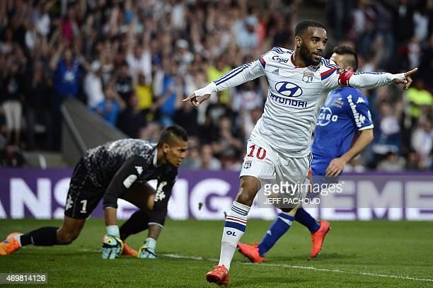 Lyon's French forward Alexandre Lacazette celebrates after scoring a goal during the French L1 football match Olympique Lyonnais vs SC Bastia on...