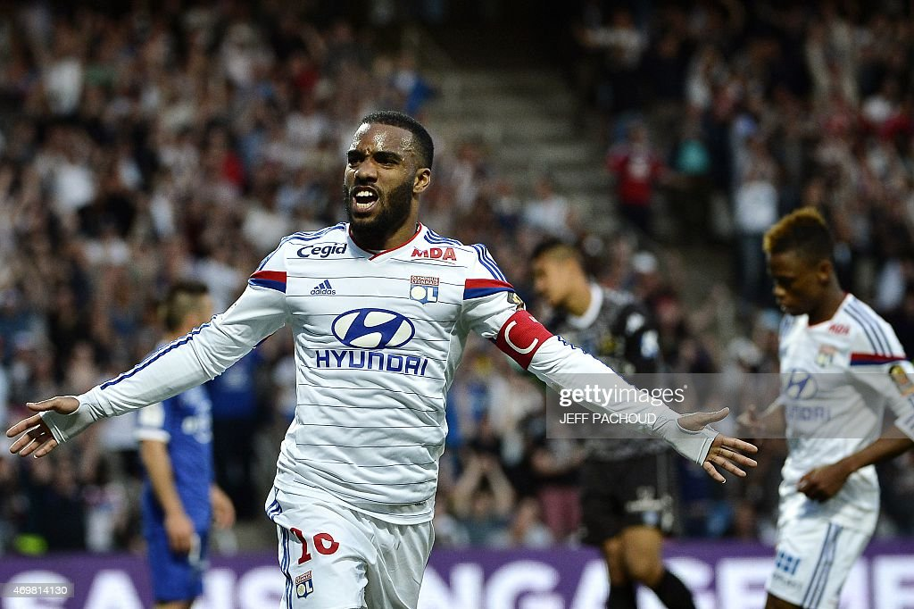 Lyon's French forward <a gi-track='captionPersonalityLinkClicked' href=/galleries/search?phrase=Alexandre+Lacazette&family=editorial&specificpeople=6927653 ng-click='$event.stopPropagation()'>Alexandre Lacazette</a> celebrates after scoring a goal during the French L1 football match Olympique Lyonnais (OL) vs SC Bastia (SCB) on April 15, 2015, at the Gerland Stadium in Lyon, central-eastern France.
