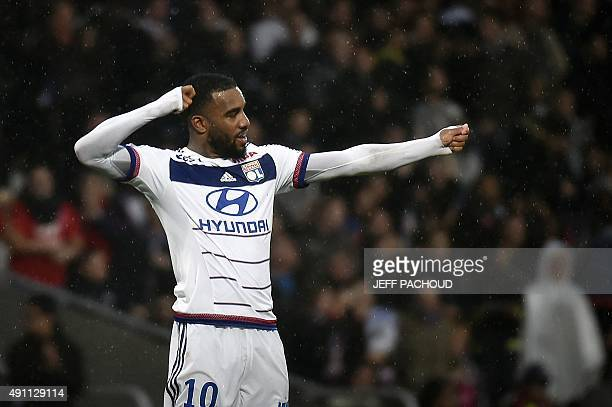 Lyon's French forward Alexandre Lacazette celebrates after scoring a goal during the French L1 football match between Olympique Lyonnais and Reims on...