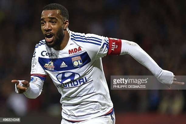 Lyon's French forward Alexandre Lacazette celebrates after scoring a second goal during the French L1 football match between Lyon and SaintEtienne at...