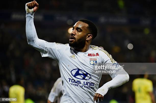 Lyon's French forward Alexandre Lacazette celebrates after scoring a goal during the French L1 football match between Lyon and Nantes at the New...