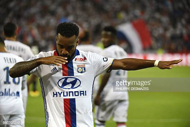 Lyon's French forward Alexandre Lacazette celebrates after scoring a goal during the French Ligue 1 football match Olympique Lyonnais against Caen on...