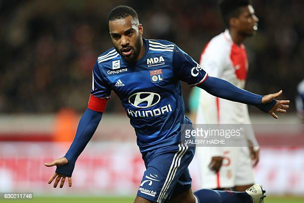 Lyon's French forward Alexandre Lacazette celebrates after scoring a goal during the French L1 football match between AS Monaco and Lyon at the Louis...