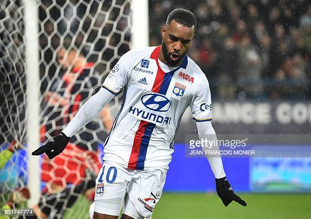 Lyon's French forward Alexandre Lacazette celebrates after scoring a goal during the French L1 football match between Caen and Lyon on January 15 at...