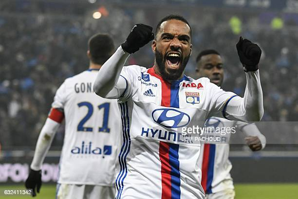 Lyon's French forward Alexandre Lacazette celebrates after scoring a goal during the French L1 football match Olympique Lyonnais vs Marseille on...
