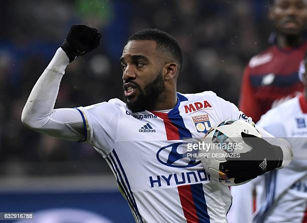 Lyon's French forward Alexandre Lacazette celebrates after scoring a penalty during the French L1 football match Olympique Lyonnais against Lille on...