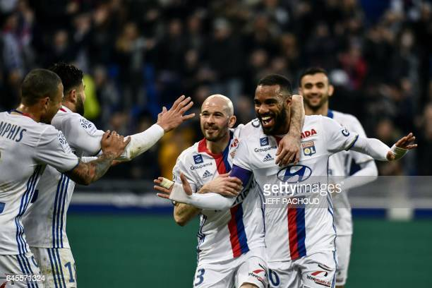 Lyon's French forward Alexandre Lacazette celebrates after scoring a goal during the French L1 football match Olympique Lyonnais vs FC Metz on...