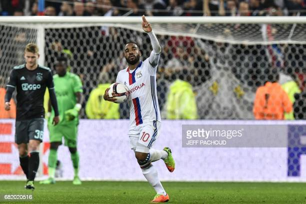 Lyon's French forward Alexandre Lacazette celebrates after scoring a goal during the Europa League semi final football match Olympique Lyonnais vs...
