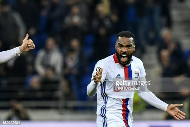 Lyon's French forward Alexandre Lacazette celebrates after scoring a goal during the UEFA Europa League semifinal football match between Olympique...