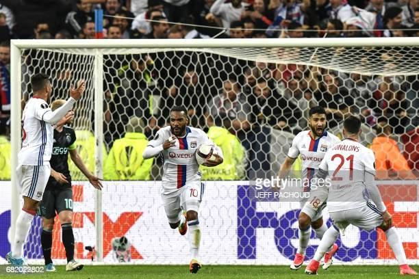 Lyon's French forward Alexandre Lacazette celebrates after scoring a second goal during the UEFA Europa League semifinal football match between...