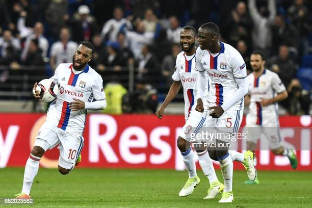 Lyon's French forward Alexandre Lacazette celebrates after scoring a second goal during the Europa League semi final football match Olympique...