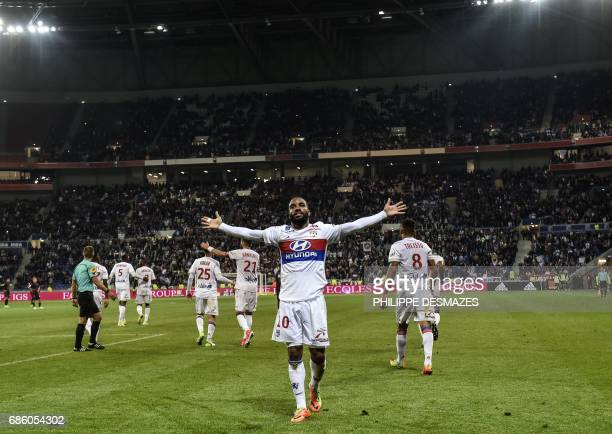 Lyon's French forward Alexandre Lacazette celebrates after scoring his 100th goal in Ligue 1 during the French L1 football match between Lyon and...