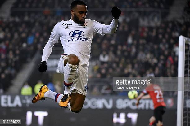 Lyon's French forward Alexandre Lacazette celebrates after scoring during the French L1 football match between Rennes and Lyon at Roazhon Park...