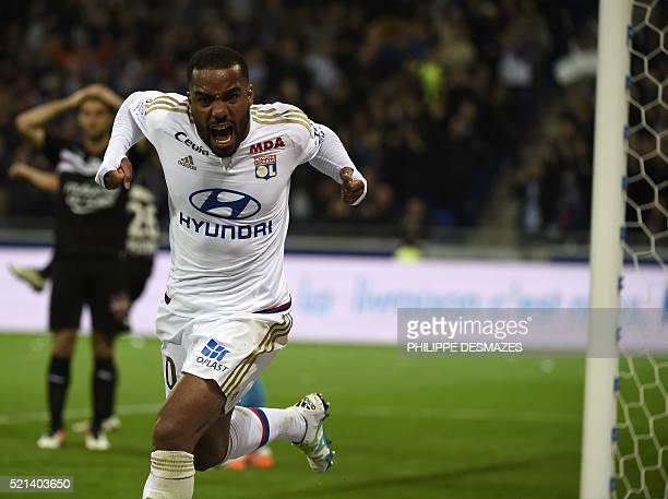 Lyon's French forward Alexandre Lacazette celebrates after scoring during the French L1 football match Olympique Lyonnais and OGC Nice on April 15 at...