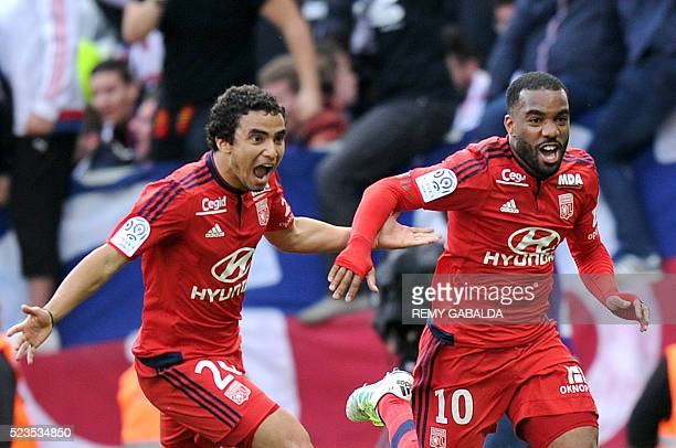 Lyon's French forward Alexandre Lacazette celebrates after scoring during the French L1 football match Toulouse against Lyon on April 23 2016 at the...