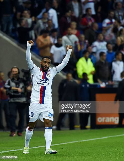 Lyon's French forward Alexandre Lacazette celebrates after scoring during the French L1 football match Olympique Lyonnais and AS Monaco on May 7 at...