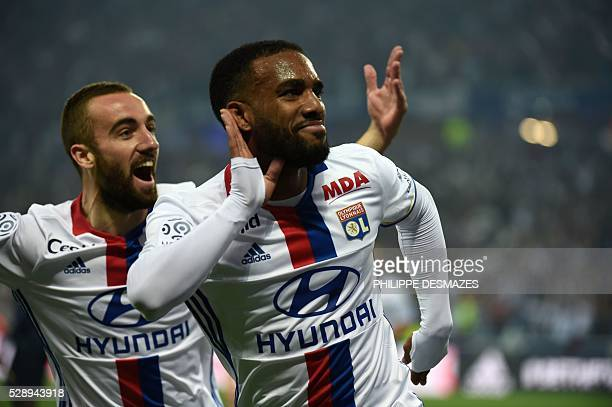 Lyon's French forward Alexandre Lacazette celebrates after scoring next to teammate Lyon's Spanish midfielder Sergi Darder during the French L1...