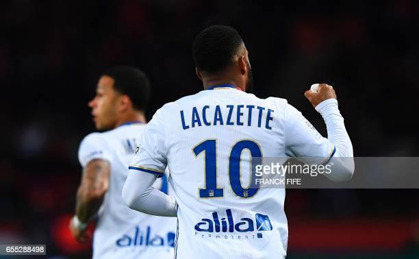 Lyon's French forward Alexandre Lacazette celebrates opening the scoring during the French L1 football match Paris SaintGermain vs Olympique Lyonnais...