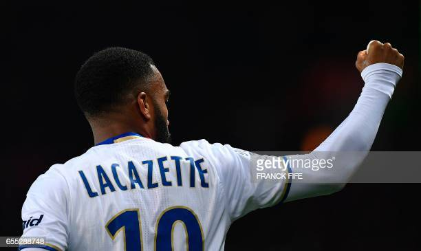 Lyon's French forward Alexandre Lacazette celebrates opening the scoring during the French L1 football match Paris SaintGermain vs Olympique Lyonnais...