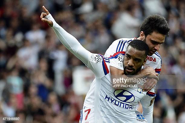 Lyon's French forward Alexandre Lacazette celebrates with Lyon's French midfielder Clement Grenier after scoring a goal during the French L1 football...