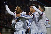 Lyon's French forward Alexandre Lacazette celebrates with teammates after scoring a penalty during the French L1 football match Olympique Lyonnais vs...